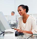 Concentrated businesswoman working at a computer