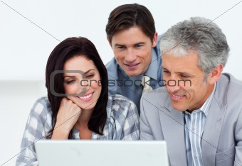 Confident business partners working at a computer 