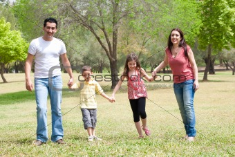 Family posing to camera in the park