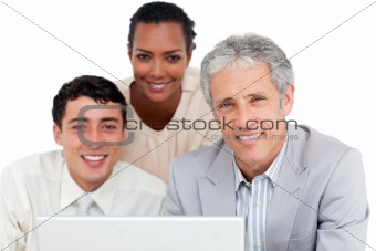 Charismatic business co-workers using a laptop