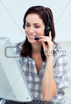 Caucasian smiling businesswoman with headset on