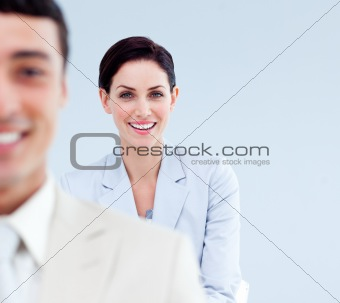 Smiling business people standing in a line
