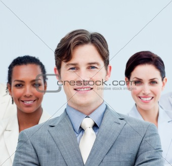 Smiling business people standing with folded arms
