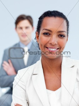 Charming business partners standing with folded arms
