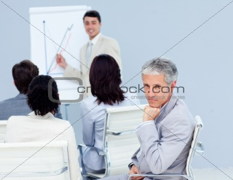 Confident businessman looking at the camera at a conference