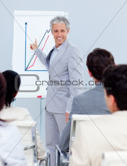 Positive mature businessman doing a presentation