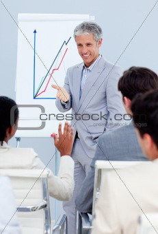 Charming businessman doing a presentation