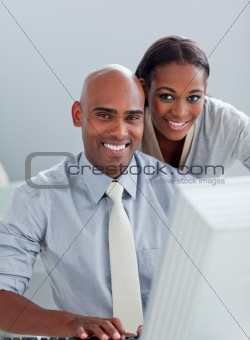 Portrait of two Afro-American colleagues working at a computer