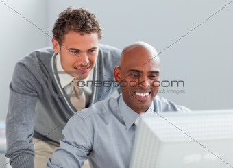 Charismatic business partners working at a computer together