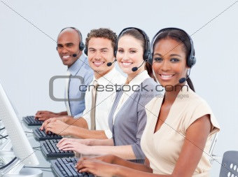 Multi-ethnic customer service representatives using headset