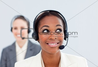 Charismatic businesswoman and her colleague with headset on