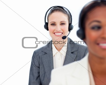 Portrait of young businesswoman and her colleague with headset o