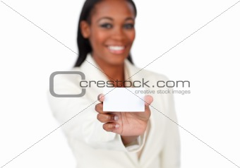Smiling afro-american businesswoman holding a white card