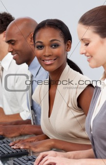 Afro-american businesswoman sitting in a line with her colleague