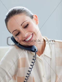 Assertive businesswoman talking on phone