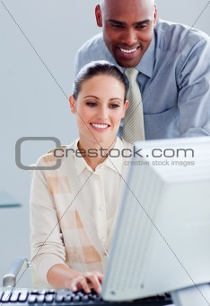 Attractive businesswoman and her manager working at a computer