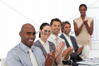 Multi-ethnic business people applauding after a presentation