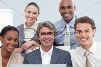 Charismatic International business people using a laptop