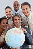 Cheerful Multi-ethnic business team showing a terrestrial globe