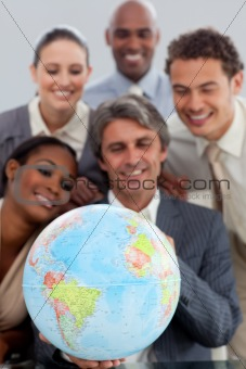 A business group showing ethnic diversity holding a terretrial g