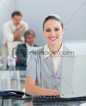 Charming businesswoman working at a computer