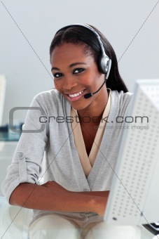 Charming ethnic customer service agent with headset on