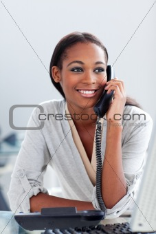 Bright Afro-american businesswoman talking on a phone