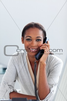 Charming Afro-american businesswoman talking on a phone