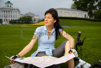 female biker with the city map