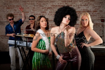 Blowing a kiss at 1970s Disco Music Party