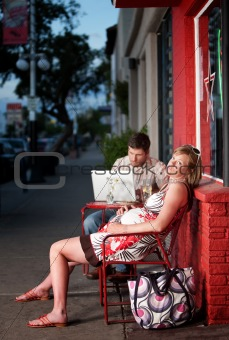 Pregnant woman resting outside on a chair