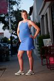 Pregnant woman posing in fitness attire