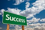 Success Green Road Sign with Copy Room Over The Dramatic Clouds and Sky.