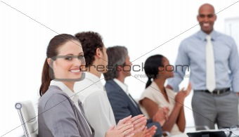 Positive business people clapping a good presentation