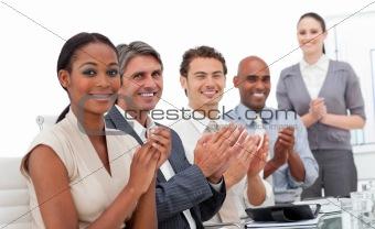Positive business team applauding a good presentation