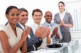 Happy business team applauding a good presentation