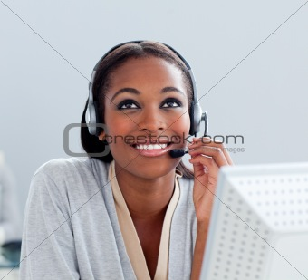 Portrait of a thoughtful businesswoman with headset on