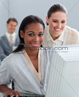 Portrait of two businesswomen working at a computer