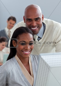 Portrait of two enthusiastic businesspeople working at a compute