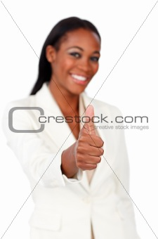 Smiling afro-american businesswoman with thumb up