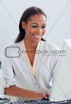 Charismatic businesswoman working at a computer