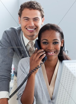 Charming business partners working at a computer