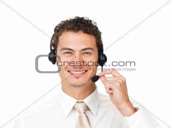 Charismatic latin businessman using headset