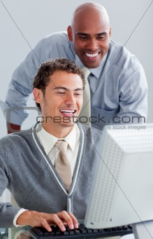 Positive business partners working at a computer