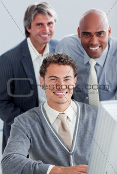 Charismatic business partners working at a computer
