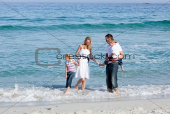 Animated family having fun at the beach