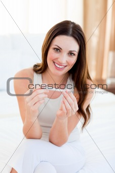 Joyful woman finding out results of a pregancy test