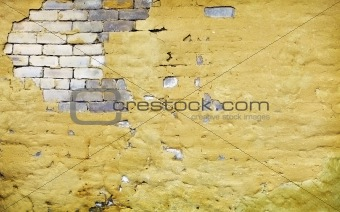 Brick wall with broken plaster