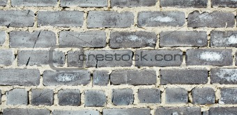Old moldy gray brick wall