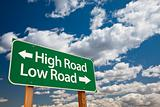 High Road, Low Road Green Road Sign with Copy Room Over The Dramatic Clouds and Sky.